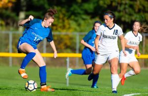 Lewis Mills' Grace Annonson (10) looks to reverse direction in front of Newington's Grace Canepari (18) during their game Tuesday at Nassahegan Field in Burlington. Jim Shannon Republican-American