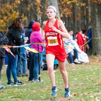 Kathryn Rodrigues of Wolcott runs toward the finish line, during the Girls NVL Cross Country Championships at Veterans Park in Watertown on Friday. Bill Shettle Republican-American