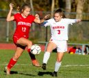 Northwestern's Alison Choquette (13) gets control of the ball in front of Wamogo's Kara Wilcox (3) during their game Monday at Northwestern Regional High School. Jim Shannon Republican-American