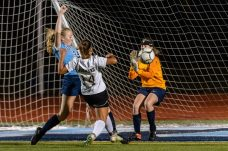 Oxford's Paige Davis, (34) tries to stop Woodland's Holly Plasky (14), center, as she tries to kick the ball past Oxford's goalkeeper Piper Geffert, right, during a girls NVL soccer match between Woodland Regional and Oxford at Oxford High School in Oxford on Thursday. Bill Shettle Republican-American