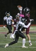 Torrington High School's Jacob Coleman makes a catch over Wilby High School's David LaBoy during the boys varsity football game in Torrington on Friday, Oct. 25, 2019. Emily J. Tilley. Republican-American
