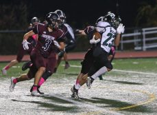 Wilby High School's Jean-Nick Dagraca tries to evade a pack of Torrington High School players during the boys varsity football game in Torrington on Friday, Oct. 25, 2019. Emily J. Tilley. Republican-American