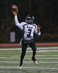 Wilby High School quarterback Aaron James throws a pass on the run during the boys varsity football game in Torrington against Torrington High School on Friday, Oct. 25, 2019. Emily J. Tilley. Republican-American