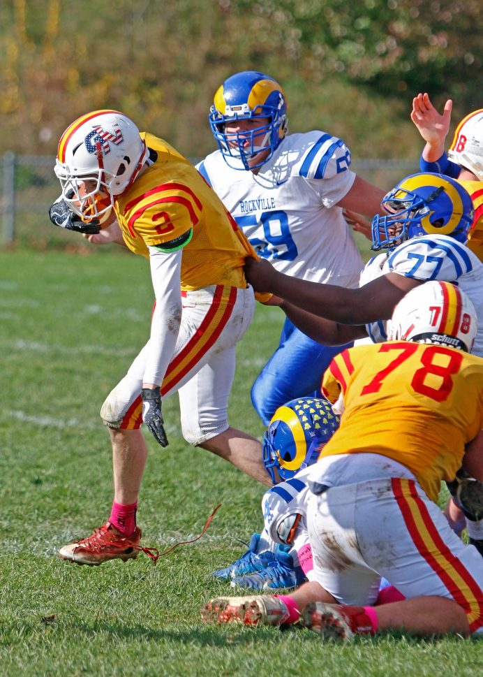 Gilbert / Northwestern's Hunter Sanden (#2) by caught up by a finger-tip tackle by Rockville's Nasir Knighton during football action at Gilbert High School in Winsted on Saturday afternoon. Rockville defeated Gilbert / Northwestern.Michael Kabelka / Republican-American