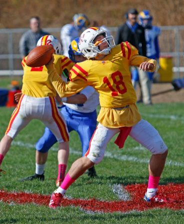 Gilbert / Northwestern's Anthony Carfiro throws against Rockville's defense during football action at Gilbert High School in Winsted on Saturday afternoon. Rockville defeated Gilbert / Northwestern.Michael Kabelka / Republican-American