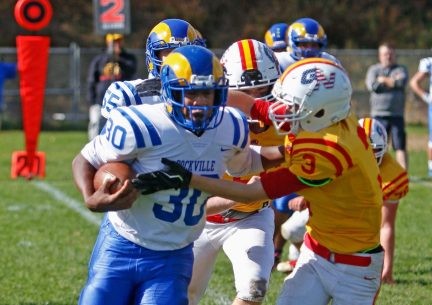 Gilbert / Northwestern's Chase Sanden makes backfield contact with Rockville's Jason Clarke during football action at Gilbert High School in Winsted on Saturday afternoon. Rockville defeated Gilbert / Northwestern.Michael Kabelka / Republican-American