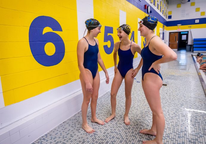 From left, Seymour swimmers Sophia Velleco, Katrine O'Leary, and Olivia Velleco have some fun before getting back into the pool, during swim practice at Seymour High School on Thursday. Bill Shettle Republican-American