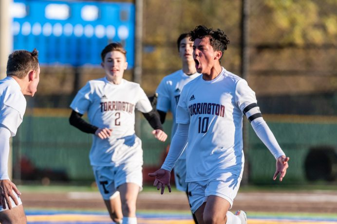 Torrington's Xavier Rodas (10), right, reacts in celebration after scoring a goal with his teammates, during the quarterfinals of the Boys NVL Soccer Tournament between Torrington and Holy Cross at Municipal Stadium on Saturday. Bill Shettle Republican-American