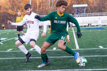 Holy Cross' Kadin Talho (11), right, puts a spin move on Torrington's Nathan Bolesh (3) along the sidelines, during the quarterfinals of the Boys NVL Soccer Tournament between Torrington and Holy Cross at Municipal Stadium on Saturday. Bill Shettle Republican-American