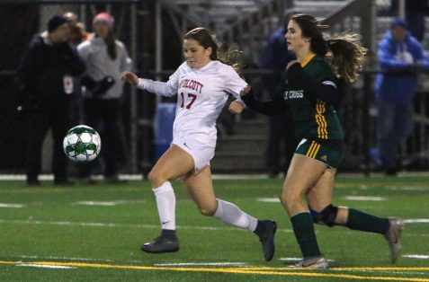 #17 Lauren Kazemekas of Wolcott High keeps the ball from #7 Sophia Vescera of Holy Cross High during the NVL soccer tournament semifinals at Municipal Stadium in Waterbury Monday. Steven Valenti Republican-American