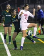 #19 Morgan Matyoka of Wolcott High tries to keep the ball from #18 Alana Snow Holy Cross High during the NVL soccer tournament semifinals at Municipal Stadium in Waterbury Monday. Steven Valenti Republican-American