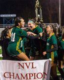 Holy Cross players Delia Murphy (11), left, and Alyssa Hebb (16), center jump up and down celebrating their win and championship over Watertown 3-2, during the NVL Girls Soccer final between Holy Cross and Watertown at Municipal Stadium on Thursday. Bill Shettle Republican-American
