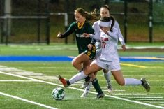 Watertown's Aubrey DiStefano (17), right, trips up Holy Cross' Julia Dane (19) as they battle for the ball, during the NVL Girls Soccer final between Holy Cross and Watertown at Municipal Stadium on Thursday. Holy Cross came from two goals down to beat Watertown 3-2. Bill Shettle Republican-American