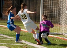 Litchfield's Sophie MadDonald (0( stops a shot from Holy Cross' Jordan Gilmore as Litchfield's Emily Dragon (14) tries to defems during their first round game in the Class S girls soccer tournament Monday at Post University in Waterbury. Jim Shannon Republican-American