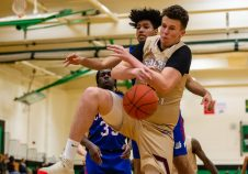 Sacred Heart's Connor Tierney (0) battles for a rebound under the basket with Crosby's Alex Batista (23), during the annual NVL Boys Hoops Jamboree at Wilby High on Sunday. City high schools competed against each other all day. Bill Shettle Republican-American