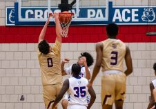 Sacred Heart's Connor Tierney (0) dunks the ball against Crosby's Alex Batista (23), during a NVL cross city Boys Basketball game between Sacred Heart and Crosby at the Palace at Crosby High in Waterbury on Friday. Bill Shettle Republican-American