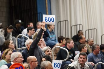 March 11, 2014: A Crosby fan holds up a '600' sign to mark Coach Nick Augelli's 600th win Tuesday night. The Bulldogs defeated Manchester, 91-54. (RA)
