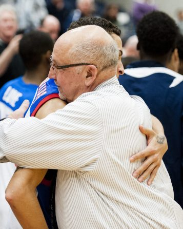 March 11, 2014: Crosby Coach Nick Augelli hugs his player Lex Perez after the Bulldogs defeated Manchester Tuesday night at home. The Bulldogs won, 91-54. The home game marked Coach Nick Augelli's 600th win and Tyshon Rogers became the NVL's all-time highest scorer. (RA)