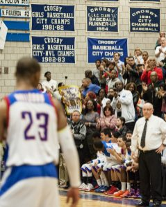 March 11, 2014: The Crosby crowd gives player (23, in front) Tyshon Rogers a standing ovation midgame after Rogers hits the mark for all time NVL scorer. He did it on a free throw at the 6:45 mark of the second quarter. The Bulldogs beat Manchester, 91-54, Tuesday night. The home game also marked Coach Nick Augelli's 600th win. Erin Covey Republican-American