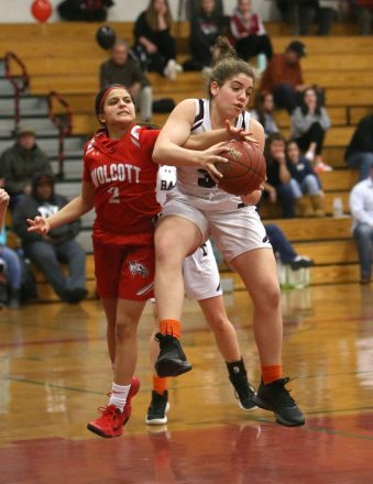 Wolcott High School's Emiah Soto tries to steal the ball from Torrington High School's Leah Pergola under the basket during the girls varsity basketball game on Thursday night, Feb. 13, 2020. Emily J. Tilley. Republican-American