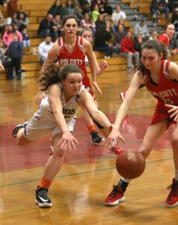 Torrington High School's Brianna Murelli dives for the ball in front of Wolcott High School's Alison LeClerc during the girls varsity basketball game on Thursday night, Feb. 13, 2020. Emily J. Tilley. Republican-American