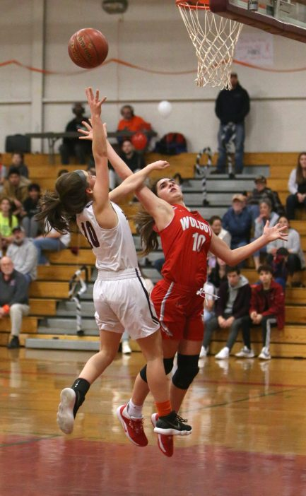 Wolcott High School's Mayci Abou Arrage tries to block a shot by Torrington High School's Marissa Burger under the basket during the girls varsity basketball game on Thursday night, Feb. 13, 2020. Emily J. Tilley. Republican-American