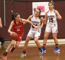 Wolcott High School's Alison LeClerc dribbles around Torrington High School's Brianna Murelli and Julianna Latina during the girls varsity basketball game on Thursday night, Feb. 13, 2020. Emily J. Tilley. Republican-American