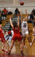 Torrington High School's Madison McLaughlin goes up for a shot over Wolcott High School's Adriana Ferrucci during the girls varsity basketball game on Thursday night, Feb. 13, 2020. Emily J. Tilley. Republican-American