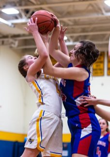Gilbert's Kimberly McCarthy (4), left, and Nonnewaug's Emily Wisniewski (24) wrestle for control of the ball, during a Girls BL basketball game between Nonnewaug and Gilbert at Gilbert High School on Thursday. Bill Shettle Republican-American