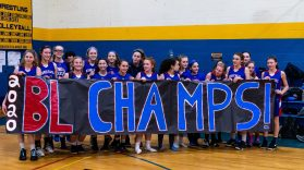 The Nonnewaug girls basketball team stand behind an unfurled banner of being the 2020 BL Champions, after the Girls BL basketball game between Nonnewaug and Gilbert at Gilbert High School on Thursday. Bill Shettle Republican-American