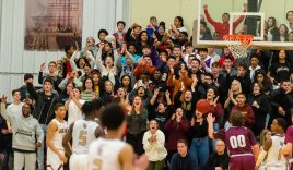 WATERBURY, CT-022120JS25- Sacred Heart fans cheer as the Heart's take the lead in the fourth quarter during their key NVL match-up with Naugatuck Friday at Alumni Hall at Sacred Heart High School. Jim Shannon Republican-American