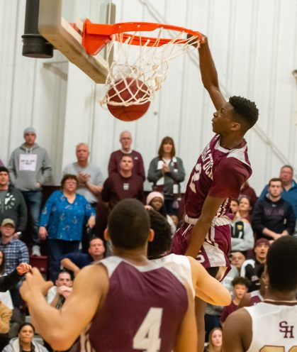 Naugatuck's Naugatuck's Ese Onakpoma (2) slams home two points during their key NVL match-up with Sacred Heart Friday at Alumni Hall at Sacred Heart High School. Jim Shannon Republican-American