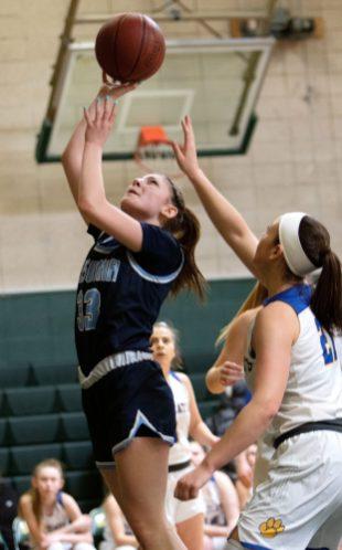 #33 Lillian Romanowski of Ansonia High puts up a shot over #21 Morgan Teodosio of Seymour High during the NVL Girls Basketball Tournament in Waterbury Saturday. Steven Valenti Republican-American