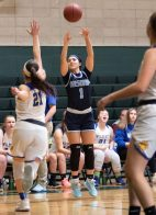 #1 Jayda Sanchez of Ansonia puts up a long shot over #21 Morgan Teododio of Seymour High during the NVL Girls Basketball Tournament in Waterbury Saturday. Steven Valenti Republican-American