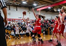 Nonnewaug's Ashley Hennessey (5) drives to the basket putting up a shot in front of Northwestern's Jana Sanden (23), during the Girls Basketball Berkshire League finals between Nonnewaug and Northwestern at Northwest Regional High School in Winsted on Friday. Bill Shettle Republican-American