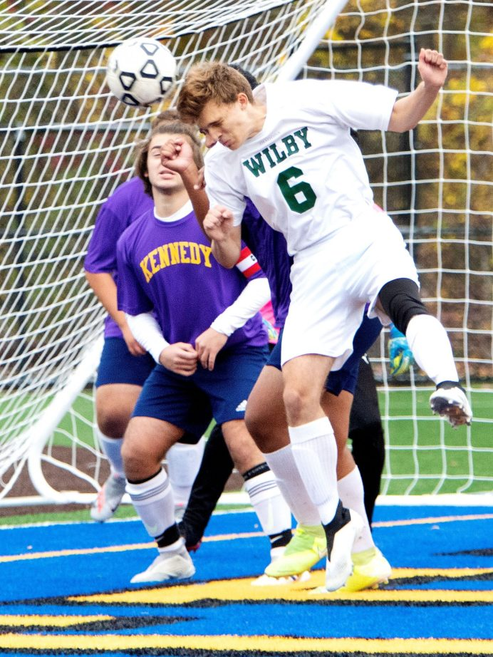 WATERBURY CT. - 23 October 2020-102320SV01-#6 Nathan Duanis of Wilby High tries to score but comes up short as #5 James Rusi of Kennedy High defends during soccer action in Waterbury Friday. Steven Valenti Republican-American