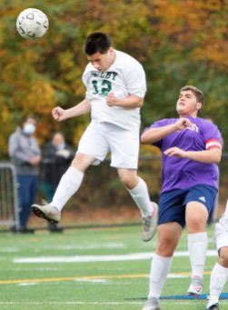 WATERBURY CT. - 23 October 2020-102320SV02-#12 Joshua Colon of Wilby High heads a ball down field as #17 Kevin Demiraj of Kennedy High defends during soccer action in Waterbury Friday. Steven Valenti Republican-American