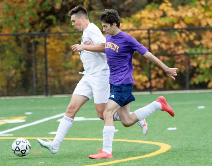 WATERBURY CT. - 23 October 2020-102320SV04-#8 Almin Cecunjanin of Wilby High tries to score as #11 Aldin Sabovic of Kennedy High defends during soccer action in Waterbury Friday. Steven Valenti Republican-American