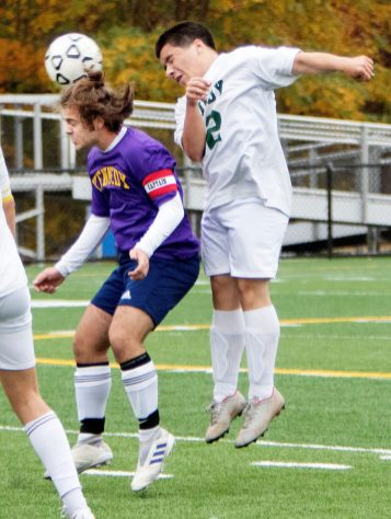 WATERBURY CT. - 23 October 2020-102320SV05-#12 Joshua Colon of Wilby High heads a ball as #5 James Rusi of Kennedy High defends during soccer action in Waterbury Friday. Steven Valenti Republican-American