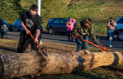 Brian O'Connell and Josh D'Archangelo, both members of the Woodland Timber Team compete in the log roll competition during the Battle Royal Friday at Woodland Regional High School. Jim Shannon Republican-American