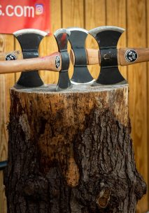Two-sided axes sit ready for use as members of the Woodland Timber Team compete in an inter-team Battle Royal Friday at Woodland Regional High School. Jim Shannon Republican-American