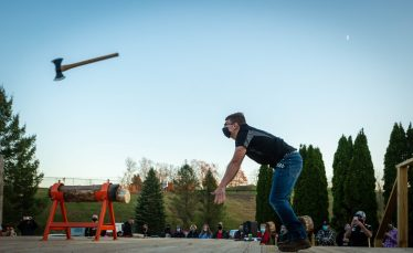 Hunter Laudate, a members of the Woodland Timber Team, competes in the axe throw competition during the Battle Royal Friday at Woodland Regional High School. Jim Shannon Republican-American