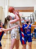 Thomaston's Sydney Eggleton (25) poys up a shot in front of Nonnewaug's Fiona Gengenbach (22) during their Berkshire League championship game Friday at Thomaston High School. Jim Shannon Republican American