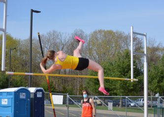 Seymour's Morgan McGuire competes in the pole vault. (Annabelle Pape/RA)
