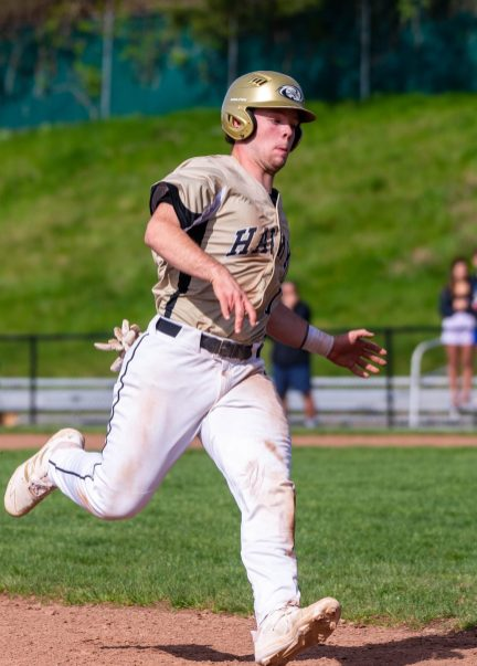 Woodland's Zach Drewry (16) makes his way into third base during their key NVL match up with Holy Cross Thursday at Woodland Regional High School. Jim Shannon Republican American