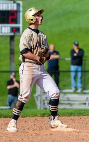 Woodland's Tyler Giambra (8) celebrates after reaching second base on a bunt during their key NVL match up with Holy Cross Thursday at Woodland Regional High School. Jim Shannon Republican American