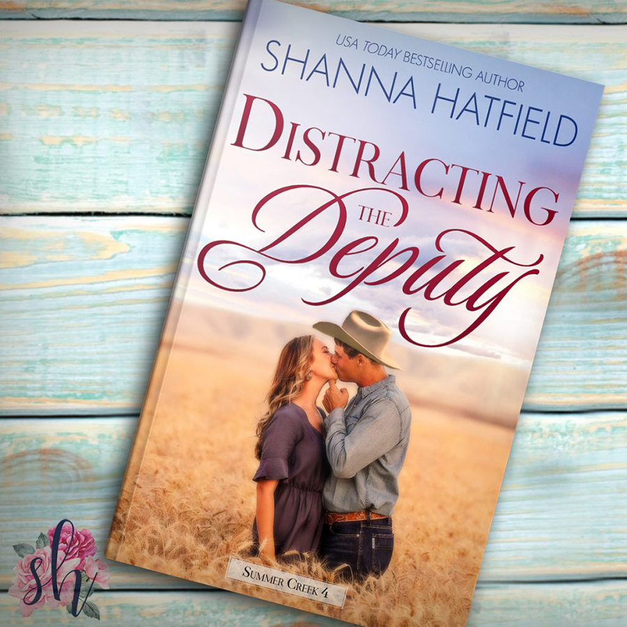 DISTRACTING THE DEPUTY, the fourth book in the adult contemporary western romance series, Summer Creek,by USA Today bestselling author Shanna Hatfield is available now