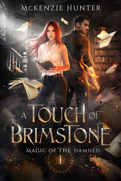 A TOUCH OF BRIMSTONE, the first book in the new adult fantasy romance series, Magic of the Damned, by McKenzie Hunter