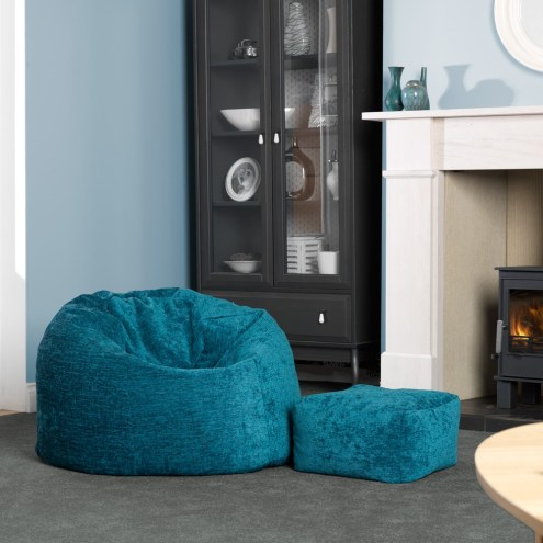 cute-blue-bean-bag-couches-set-on-grey-rug-in-front-of-wooden-cabinet-and-fireplace-mantel