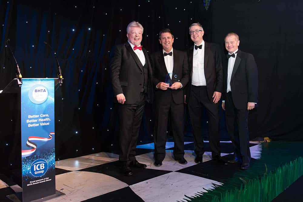 BHTA Awards NRS Healthcare accepting award